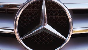 Mercedes-Benz logo amid an emissions scandal