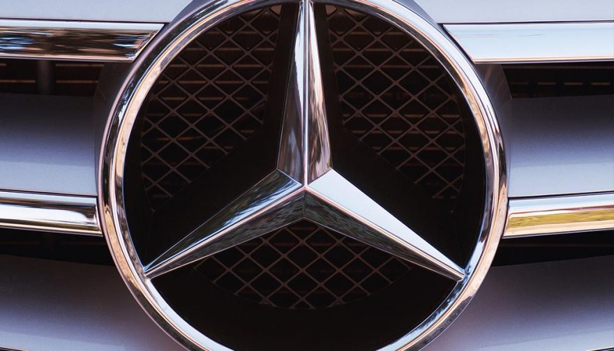 Mercedes-Benz logo amid an emissions scandal