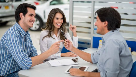 A customer uses car buying tips when purchasing a new car.