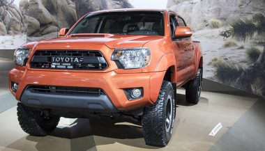 An orange 2016 Toyota Tacoma