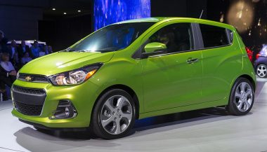 A green Chevy Spark is a new inexpensive car