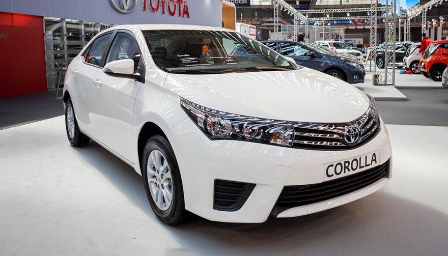 A white Toyota Corolla