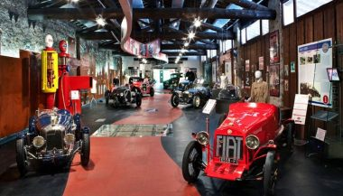 The inside of a car museum shows the appeal these facilities have for car enthusiasts