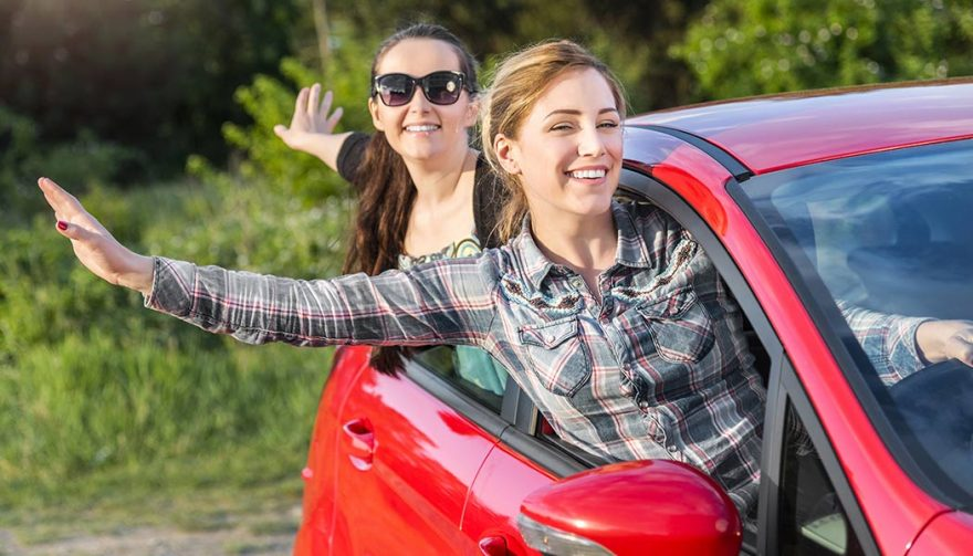 Women in a car wonder if they should own a car