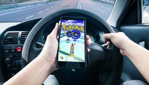 A driver playing Pokemon Go shows the dangers of distracted driving