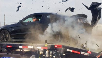 A tire explodes on a dyno, causing extensive damage to the rear of the car