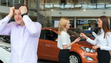 A man shows frustration car shopping with his partner