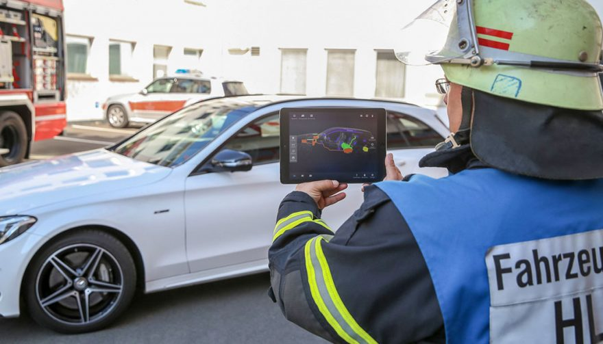 A firefighter demonstrates the new Merecedes safety app