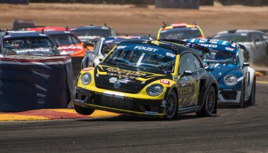 A VW Beetle struggles to maintain its lead during the Global Rallycross