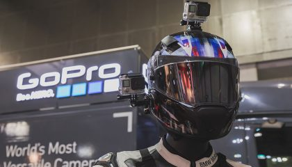 A GoPro camera mounted on a motorcycle helmet.
