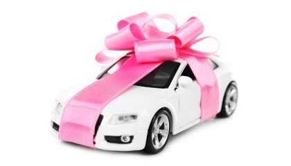 A car wrapped as a present shows some gift ideas for car lovers.