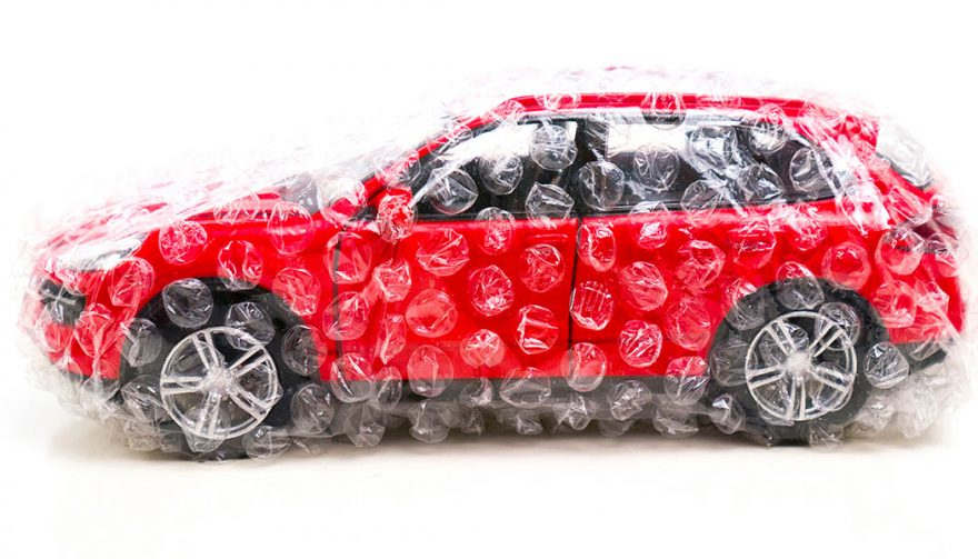 A car wrapped in plastic, as if buying your first new car