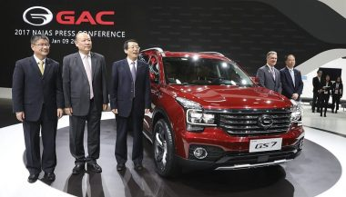 GAC Motors executives standing next to the GS7 mid-size SUV