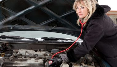 A woman listens to determine the source of engine noises