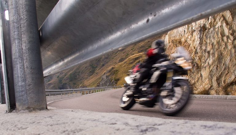 A rider avoids motorcycle accidcents on a curvy road