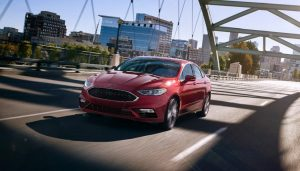 The 2017 Ford Fusion drives across a bridge