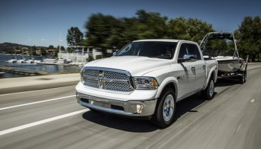A 2017 Ram 1500 truck tows a large boat
