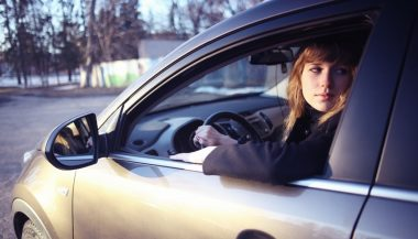 Driving tips for beginners like this young woman include staying calm