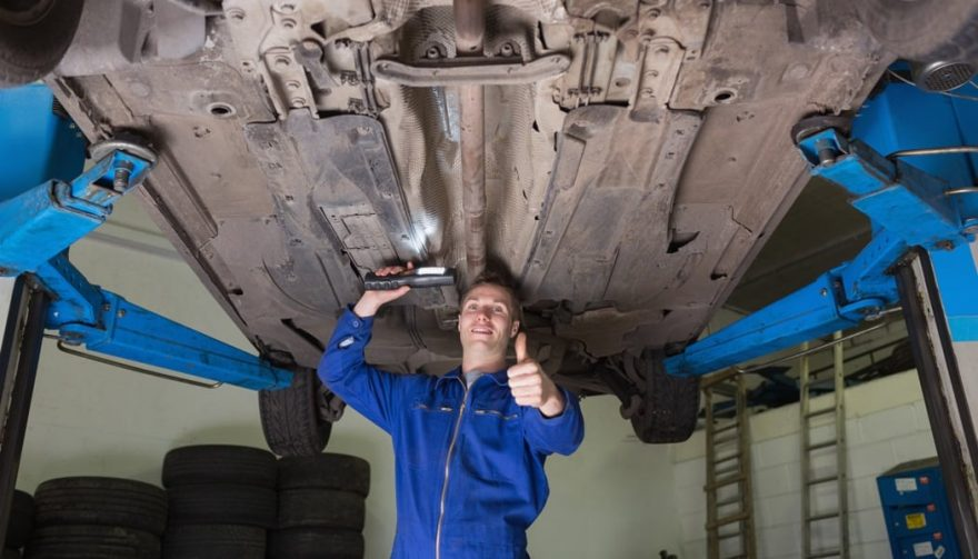 A mechanic performs car modifications