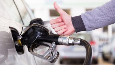 A driver is happy after learning how to save gas