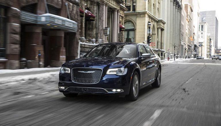 A 2017 Chrysler 300 drives down a street