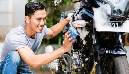 A man knows how to clean a motorcycle the right way