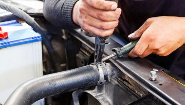 A mechanic working on a car knows how to fix a leakyk radiator