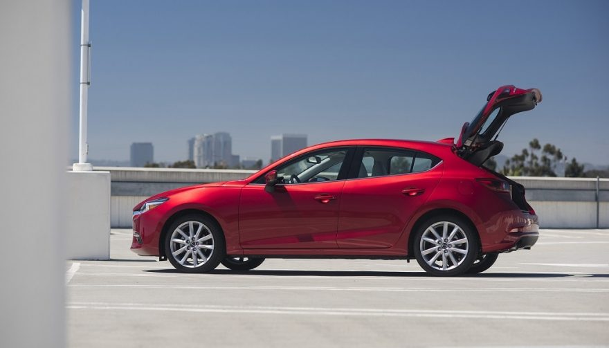 A door lifting up shows a difference in the hatchback vs wagon debate
