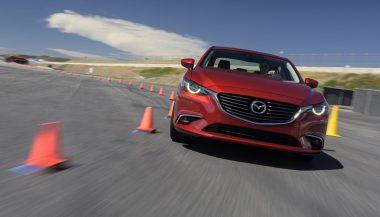 A car uses g-vectoring control through a turn