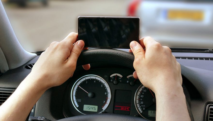 A driver is texting and driving