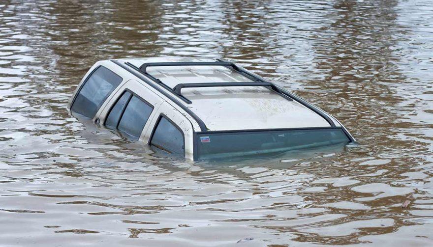 A flood damage car is under water