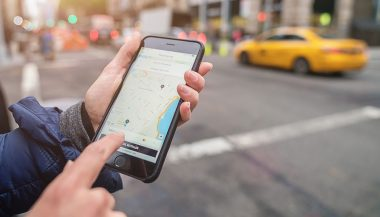 A person uses a ride hailing service app