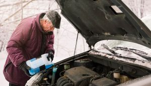 A man knows how to work on your car in the cold