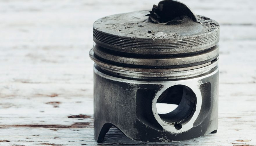 A piston is broken as a result of low speed pre ignition