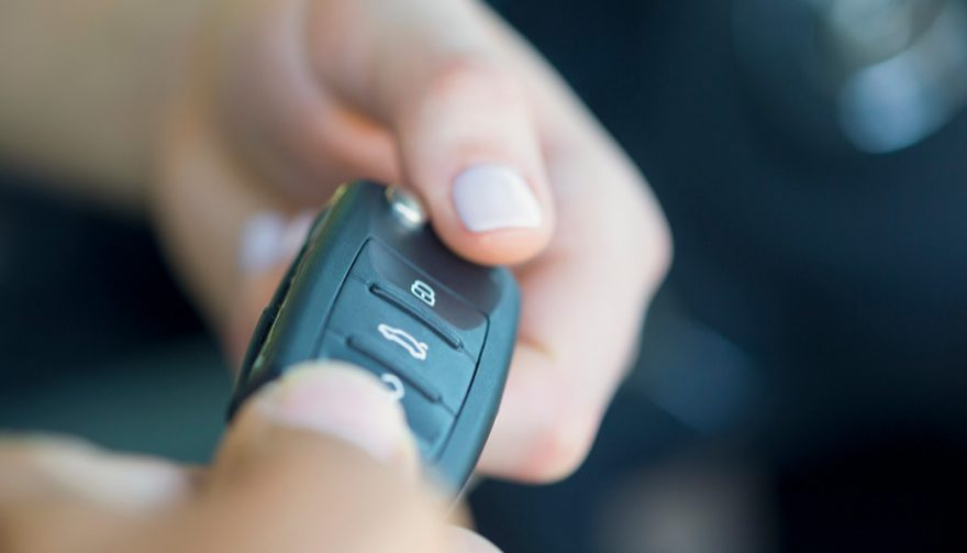 A dealer uses the four square car sales method before handing over the keys