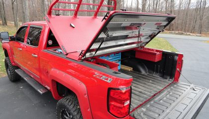 A red truck, sporting various truck accessories.