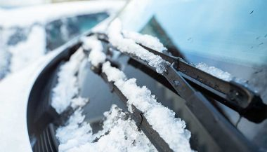 Melting snow on windshield wipers.
