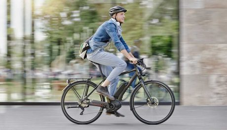 A man riding on an electric bike.
